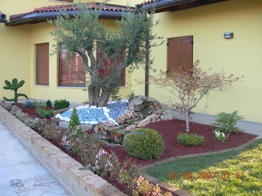 Giardini con aiuole decorare il giardino con i sassi idee fai da te foto nanopress con aiuole - Idee per realizzare un giardino ...